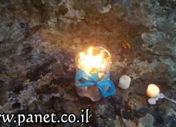 lightening candles in Kisra - panet